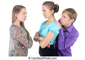 Cowardly blond man and two young women on white background