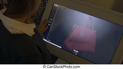 3D model of a bag on touchscreen monitor