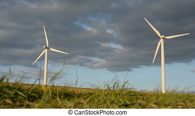 Wind Energy - Two modern windmills rotating in high-wind