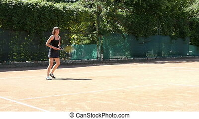 Woman Plays Tennis At Training Slow Motion - Woman in...