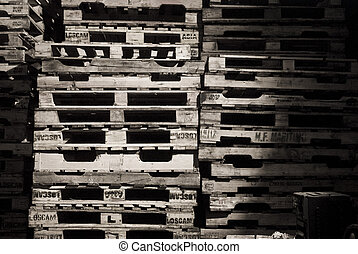 Piles of wooden pallets in balck and white.