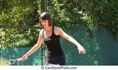 Young Woman Playing Tennis Slow Motion