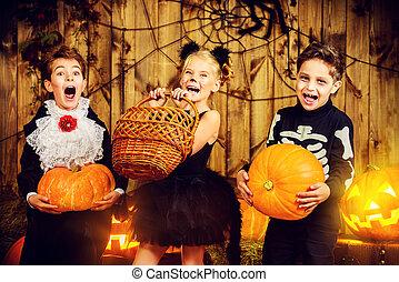 autumn holiday - Group of joyful children in halloween...