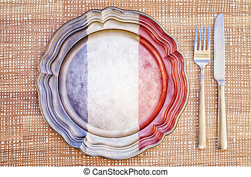 French Cuisine Concept - French Cuisine - Plate and Cutlery...