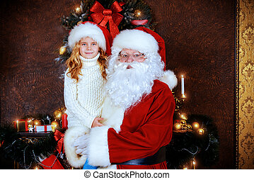 happy childhood - Santa Claus holds on hands happy little...