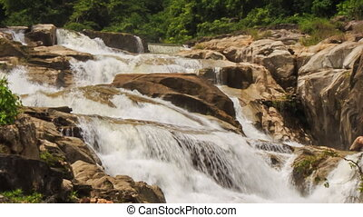 closeup view of waterfall among rocks in park
