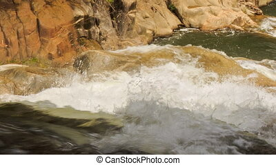 upper view of foamy mountain stream among stones in park -...