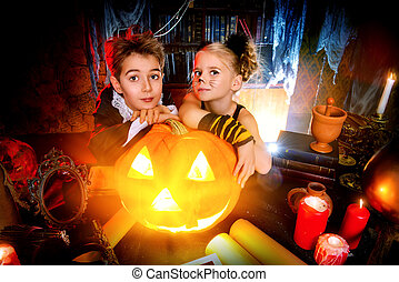magic pumpkin - Two cute children dressed as a vampire and a...