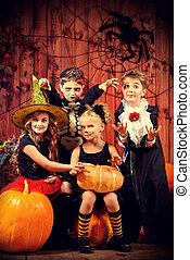 trick-or-treating - Cheerful children in halloween costumes...