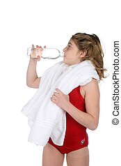 girl drinking water after working out