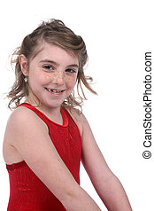 young girl in red leotard smiling with a missing tooth