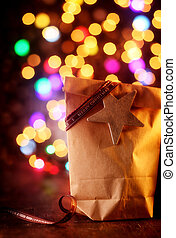 Simple Christmas gift with a colorful party bokeh - Simple...