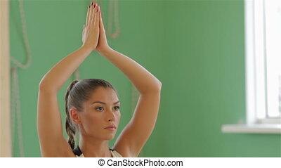 Young brunette girl practising yoga. Fitness, yoga, sport,...