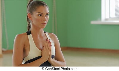 Portrait of serene girl doing yoga exercise in gym