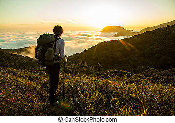 Hiker enjoying the Sunset and Amazon Forest - Hiker with...