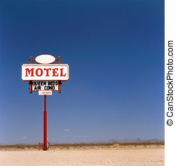 Old motel sign in the desert. This photo has been made on...