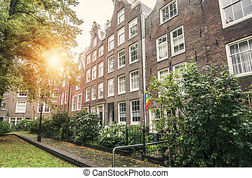 Houses in Amsterdam - Odd Classic Brick Houses in Amsterdam,...