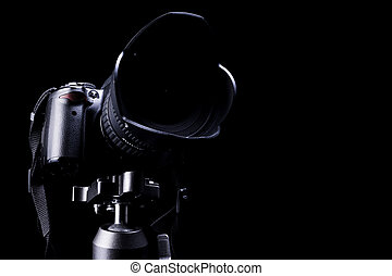 Professional DSLR camera on dark background - Professional...