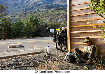Poor Traveler Man waiting for a Ride near a Road where...