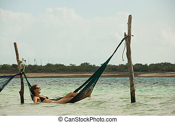 Woman Relaxing with Hammock Inside the Sea
