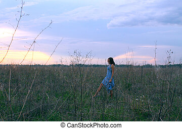 sad girl walking in the field
