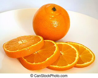 Tangerine and slices on white background