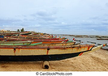 Africa Senegal Atlantic coast fishermen boats in a row