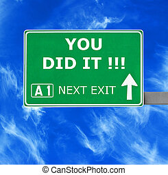 YOU DID IT road sign against clear blue sky