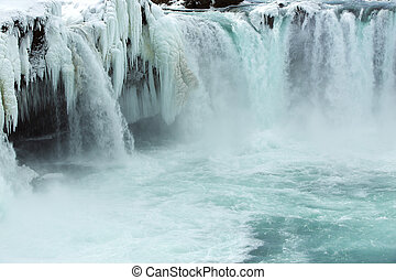 Closeup of frozen waterfall Godafoss, Iceland - Closeup of...