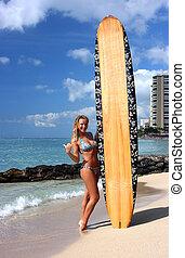 Surfing on waikiki - Surfing girl with surf board on waikiki...