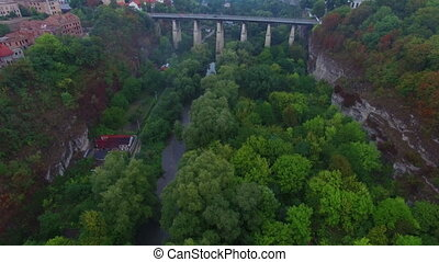 Aerial shot of bridge in canyon