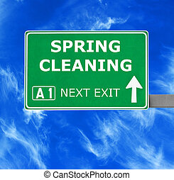 SPRING CLEANING road sign against clear blue sky