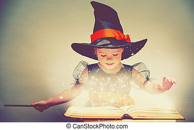 Halloween. cheerful little witch with a magic wand and...