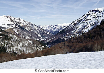Aspe Valley seen in winter from Somport pass in Pyrenees -...
