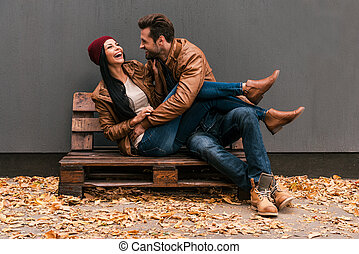 Carefree time together. Beautiful young couple having fun...