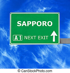 SAPPORO road sign against clear blue sky