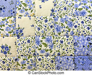 blue floral quilt - Close up of an old-fashioned blue floral...
