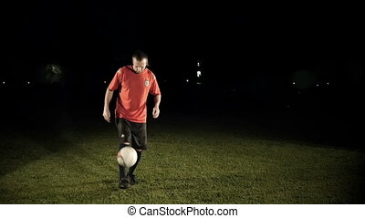 Soccer Player Kicking The Ball Slow Motion - Soccer player...