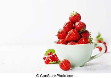Strawberry - Strawberries in cup on rustic background