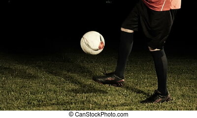 Close Up Soccer Player Juggling A Ball Black Background Slow Motion
