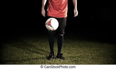 Kicking A Soccer Ball On Field At Night Slow Motion