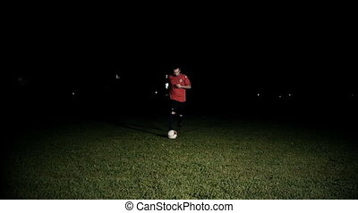 Player Dribbling A Ball Slow Motion - Soccer player...