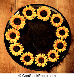 Colorful yellow round sunflower frame of a ring of fresh...