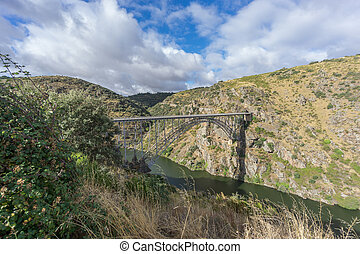 Side view of Requejo iron Bridge, Castile and Leon, Spain -...