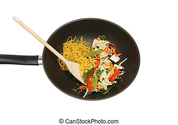 Stir fry ingredients with a wooden spoon in a wok isolated...