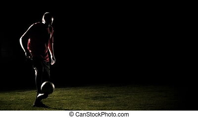 Player Juggles A Ball Slow Motion - Soccer player on black...