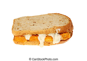 Fish finger sandwich with tartar sauce isolated against...