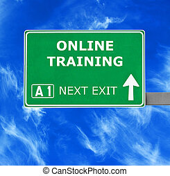 ONLINE TRAINING road sign against clear blue sky