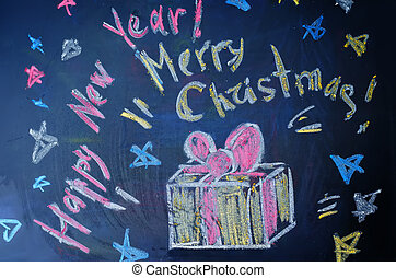Happy new year and merry Christmas written with chalk on a...