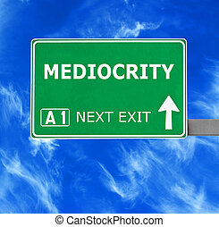 MEDIOCRITY road sign against clear blue sky